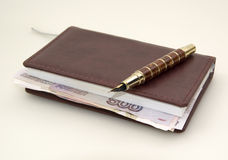 Ruble money inside the diary, and pen Royalty Free Stock Photo