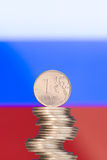 Ruble over the Russian flag Royalty Free Stock Image