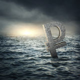 Ruble sign sinking in water Royalty Free Stock Photo