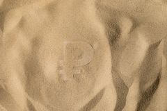 Ruble Symbol Under the Sand. Russian Ruble Symbol or Sign Covered with Sand in the Sun after Crisis royalty free stock image
