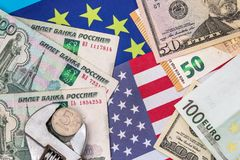 Ruble in vise with money and flag. Of europe and usa stock images