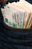 Ruble w jego kieszeń cajgi Obrazy Royalty Free