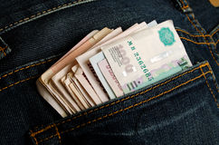 Rubles in his pocket jeans. Stock Image