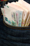 Rubles in his pocket jeans. Royalty Free Stock Images