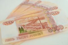 5000 rubles lie on a white table close up. 5000 rubles lie on a white table close up royalty free stock photo