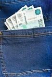 Rubli in tasca delle blue jeans Fotografia Stock