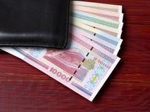 Rublo bielorrusso na carteira preta Imagem de Stock Royalty Free