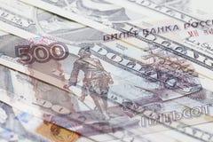 Rublo rusa y dólar de EE. UU. Fotos de archivo