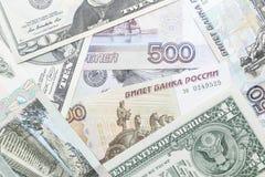 Rublo rusa y dólar de EE. UU. Foto de archivo