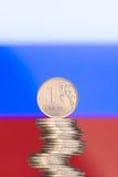 Rublo sobre la bandera rusa Imagen de archivo libre de regalías