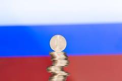Rublo sobre la bandera rusa Imágenes de archivo libres de regalías