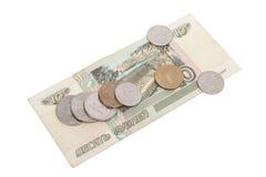 Rublos rusas de billetes de banco y monedas Fotografía de archivo libre de regalías