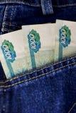 Rublos rusas de palillo fuera de vaqueros del cadera-bolsillo Fotografía de archivo