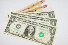 200 rublos y tres dólares Imagenes de archivo