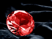 Ruby. A close up on a Ruby jewel on a dark background. Shallow DOF Royalty Free Stock Photos