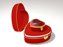 Ruby in a box. Ring with a ruby ​​in the red box in the shape of a heart Stock Image