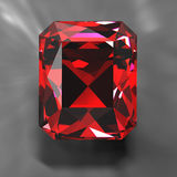 Ruby. Bright ruby on gray beckground Royalty Free Stock Photos