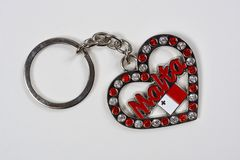 Ruby and diamond Maltese keyring. Ruby and diamond encrusted heart shaped Maltese keyring against a white background Stock Photo