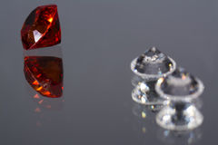 Ruby and diamonds. On grey background Royalty Free Stock Photography