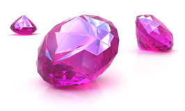 Ruby gemstones on white surface. Royalty Free Stock Photography