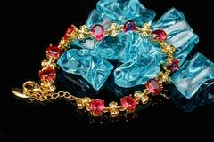 Ruby gold bracelet isolated Stock Photos
