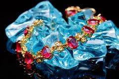 Ruby gold bracelet isolated Stock Images