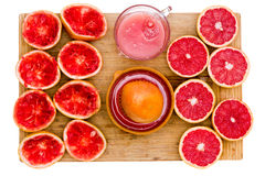 Ruby grapefruit still life with juice and juicer Stock Image