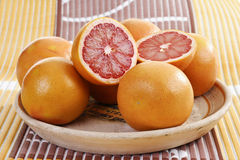 Ruby grapefruits in fruit bowl Royalty Free Stock Photos