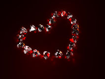 Ruby heart. Heart made of rubys, isolated on dark surface. 3d render Royalty Free Stock Photography