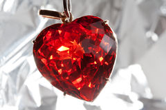Ruby heart-shaped precious stone. Red presious stone pendant in heart shape Royalty Free Stock Image