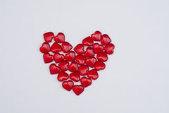 Ruby hearts on white background Stock Images