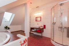 Ruby house - Bathroom in the attic. Ruby house - Modern and original bathroom in the attic Stock Photos