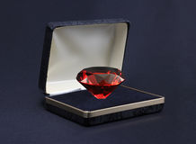 Ruby in Jewel Box. A large red ruby in a velvet and gold jewel box Stock Image