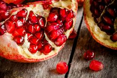 Ruby pomegranate grains closeup on a table Royalty Free Stock Image