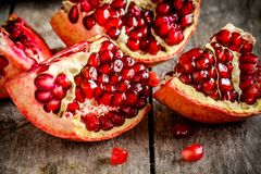 Ruby pomegranate grains closeup on a table Royalty Free Stock Photo