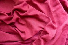 Ruby red cotton fabric in soft folds. Ruby red cotton jersey fabric in soft folds Stock Photography