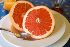 Ruby Red Grapefruit Breakfast. Breakfast of two halves of pink grapefruit Royalty Free Stock Photography
