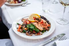 Ruby red trout with rice and vegetables. stock images