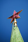 Ruby star of Spassky tower on the dark blue sky Stock Photography