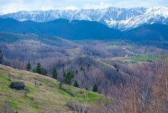 Rucar Bran durring springtime. Piatra Craiului Mountains seen from Rucar Bran road stock photos