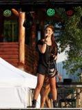 Rucar, ROMANIA – SEPTEMBER 13 2014: Roxana Postelnicu singer from Heaven band in concert Stock Photo