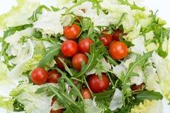 Ruccola, φύλλα μαρουλιού και ντομάτες κερασιών Στοκ εικόνα με δικαίωμα ελεύθερης χρήσης