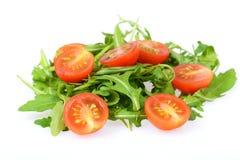 Ruccola con i pomodori Fotografia Stock