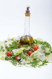 Ruccola, lettuce,  tomatoes and olive oil Stock Photography