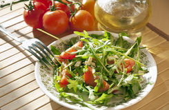 Ruccola salad with goat cheese and cherry Royalty Free Stock Image