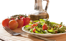 Ruccola salad with goat cheese and cherry royalty free stock images