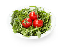 Ruccola and tomatoes in white bowl Stock Photos