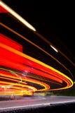 Ruch drogowy noc Minicurves Dwa Zdjęcia Royalty Free