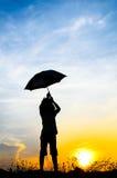 Ruch plamy skokowa Parasolowa dziewczyna z zmierzchem Zdjęcie Royalty Free