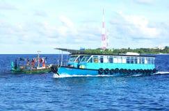 Ruchliwie łodzie w Maldives Męskich Zdjęcie Royalty Free